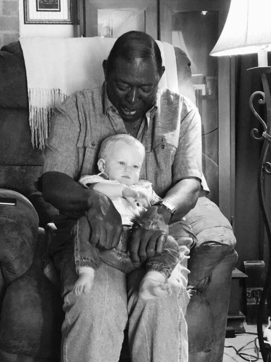 Milton West Holds Cody Shugart's Baby, Photo Goes Viral
