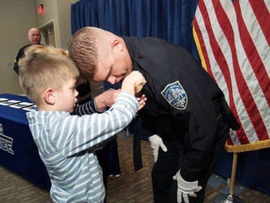 Officer James Hurst Cuddles Abandoned Toddler, Photo Goes Viral