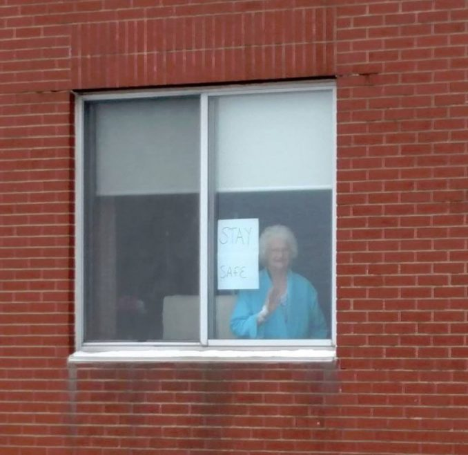 Gloria Porter Puts Sign On Hospital Window For Ironworker
