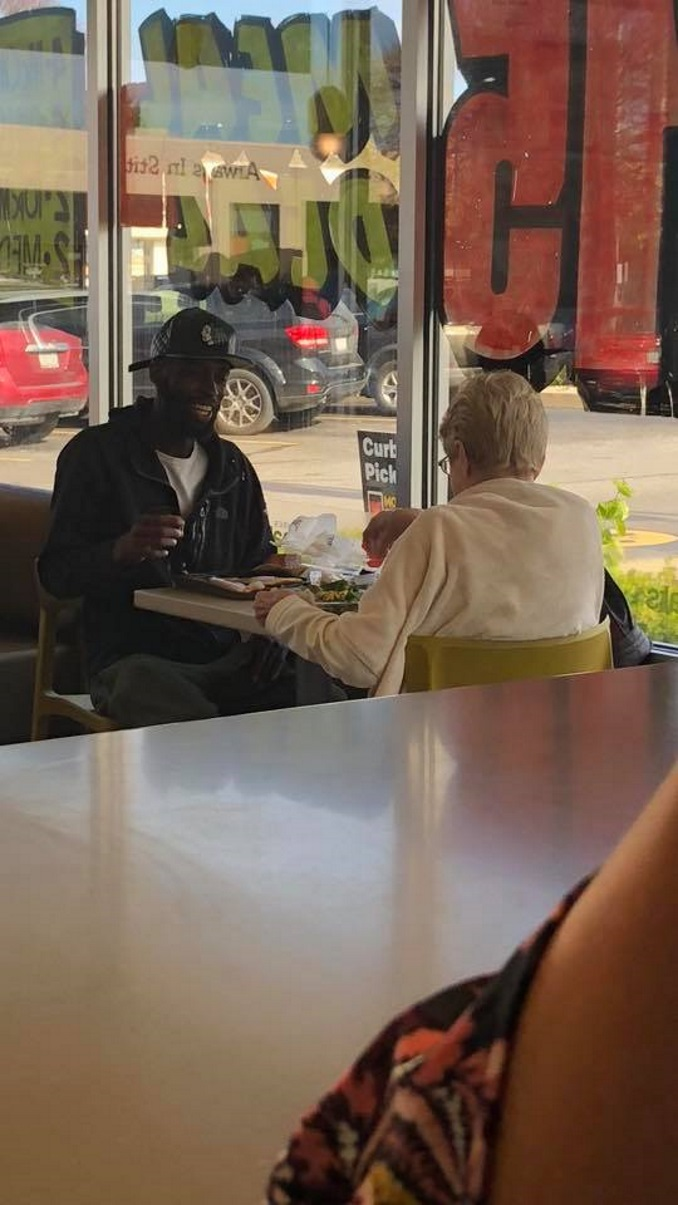 Amanda Craft Snaps Viral Photo Of Strangers Sharing A Meal